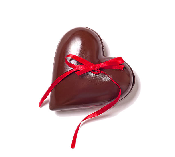 chocolate heart and red riibbon stock photo