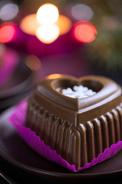 Chocolate Heart Cake with White Snowflake for New Year's Eve stock photo