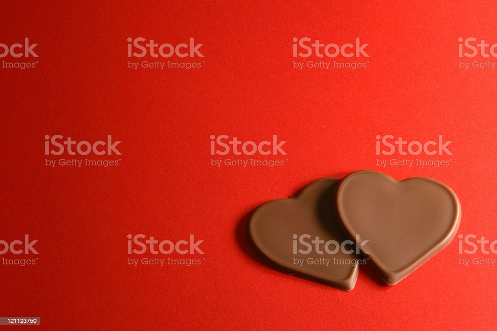 Chocolate Hearts on Red royalty-free stock photo