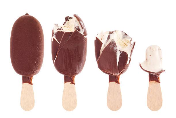 Chocolate ice cream being eaten up stock photo
