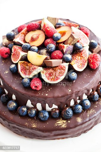 472311978 istock photo Chocolate icing cake, decorated with fresh fruit 522817717