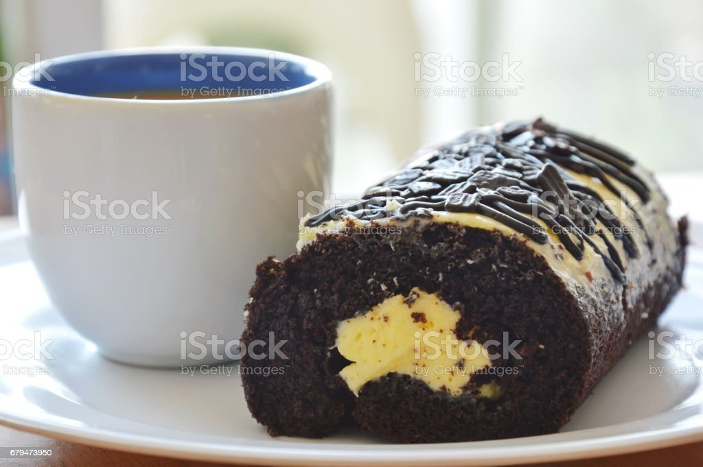 chocolate jam roll filled cream with coffee 免版稅 stock photo