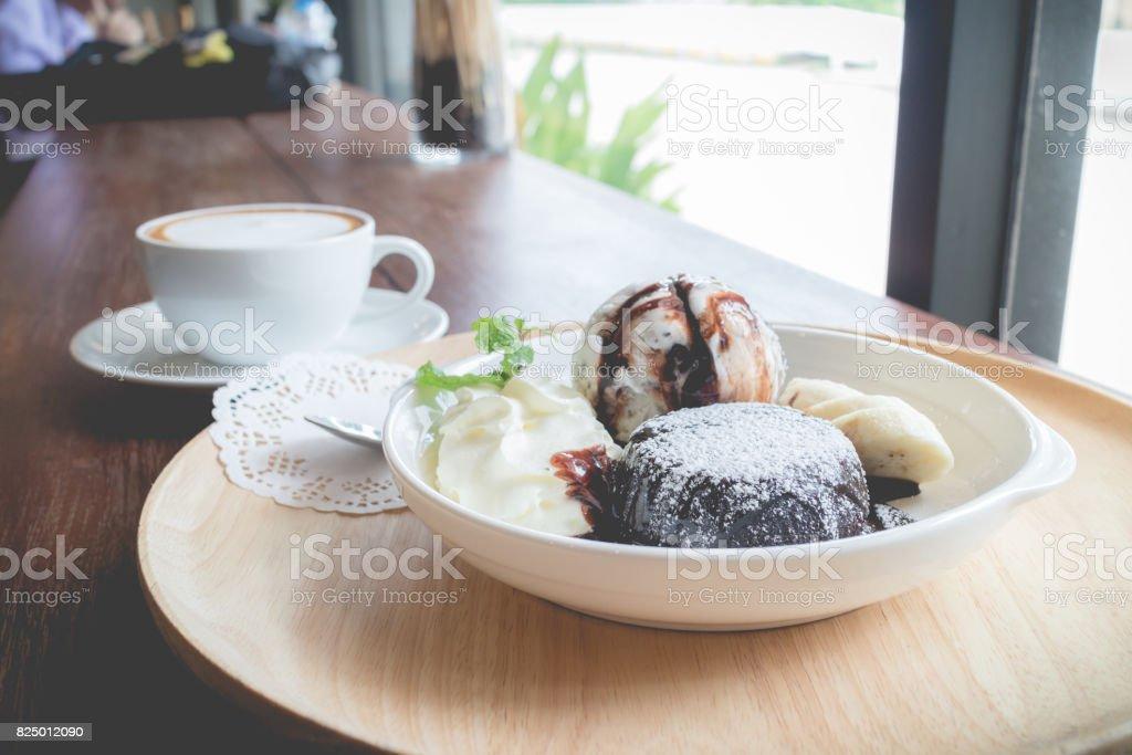 Chocolate lava cake with vanilla ice cream, banana and whipped cream stock photo