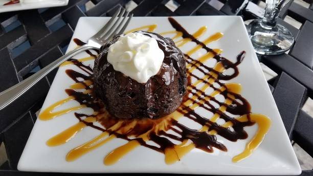 Chocolate Lava Cake with Whipped Cream and garnished with Chocolate and Caramel stock photo