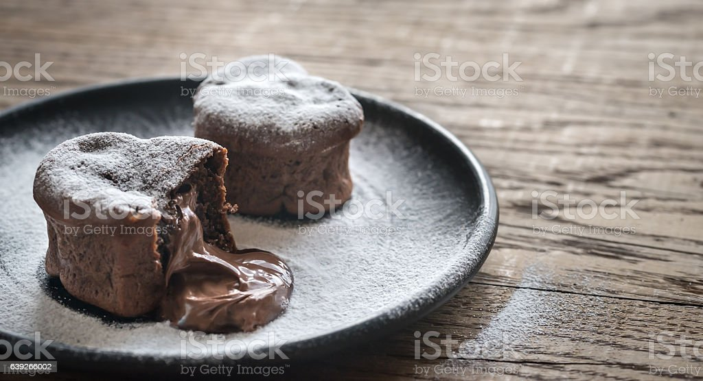 Chocolate lava cakes in the shape of heart stock photo
