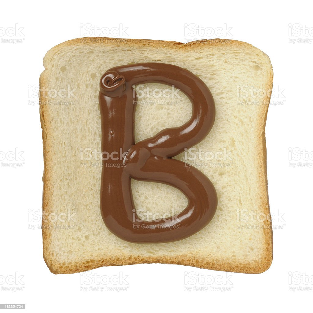Chocolate letter B on a tinloaf slice, white background royalty-free stock photo