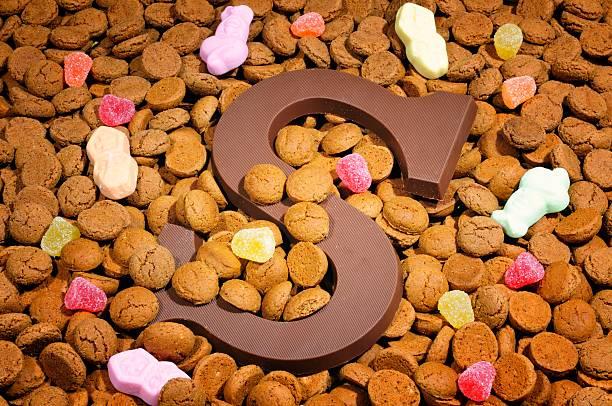 chocolate letter s and pepernoten - kruidnoten stockfoto's en -beelden