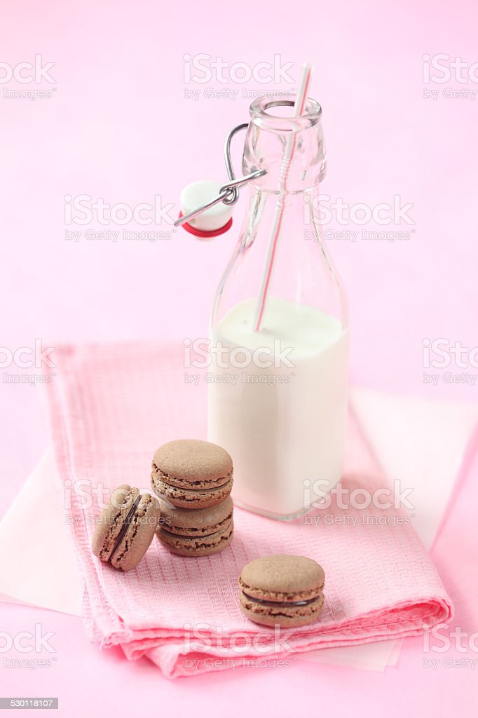 Chocolate Macarons and bottle of milk stock photo