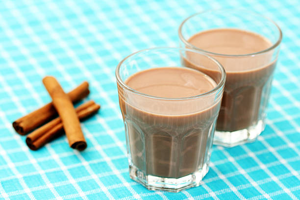 chocolate milk chocolate milk with cinnamon - food and drink chocolate milk stock pictures, royalty-free photos & images