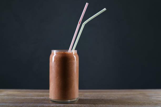 Chocolate milkshake on restaurant table, refreshing cold drink. stock photo