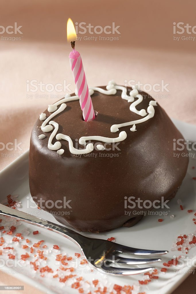 Chocolate Mini Birthday Cake with candle stock photo