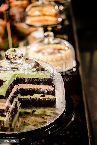 istock Chocolate mint layer cake under glass dome 959725872