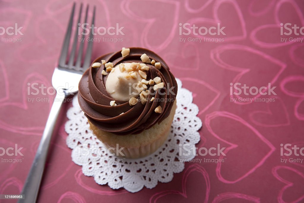 chocolate mocha icing cupcake with nuts royalty-free stock photo