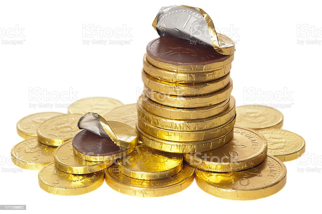 Chocolate money coins stacked on white royalty-free stock photo