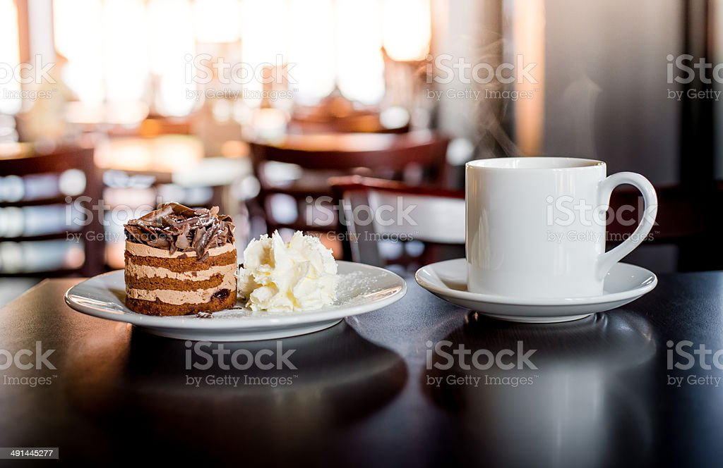 chocolate mousse cake with cream and coffee stock photo