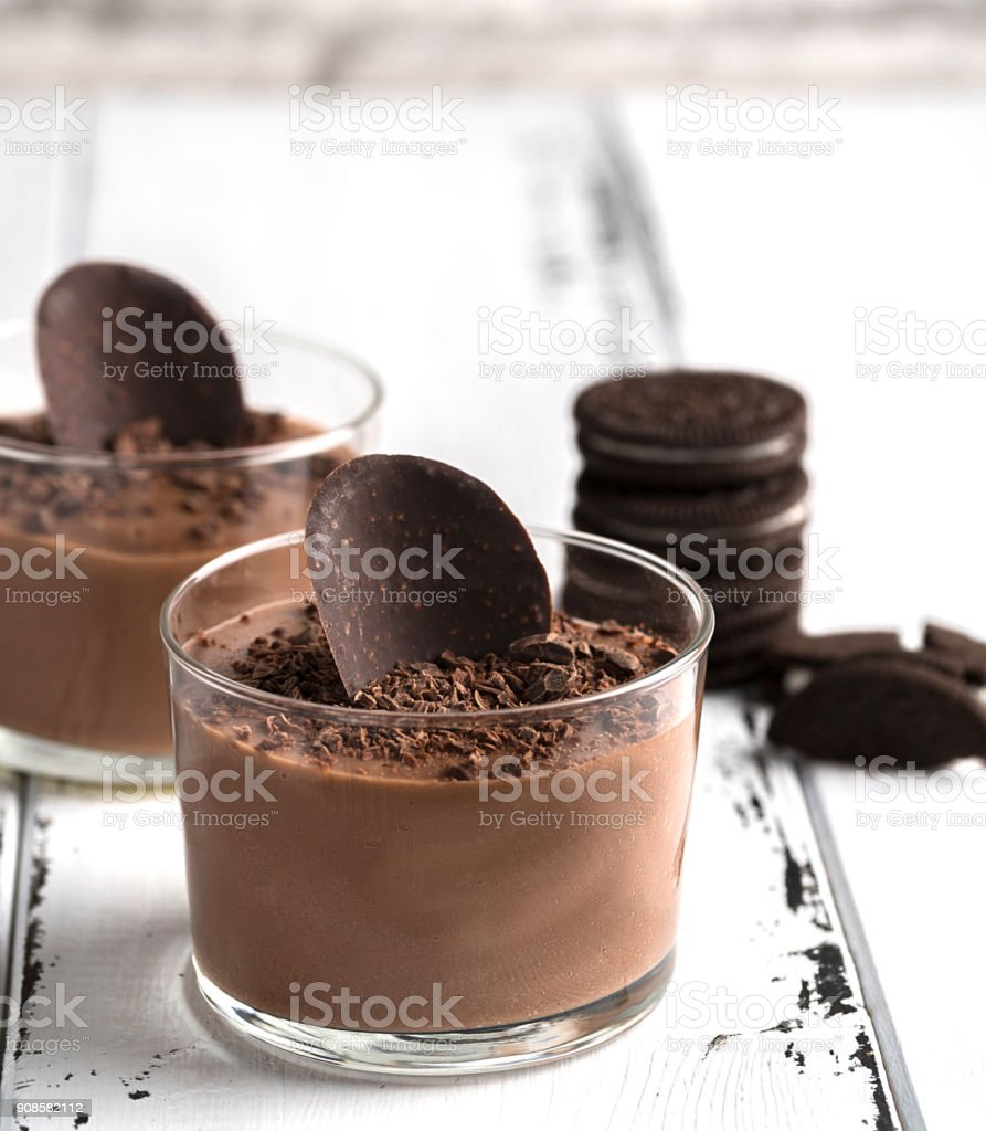 Chocolate mousse in a glasses on a white wood background. stock photo