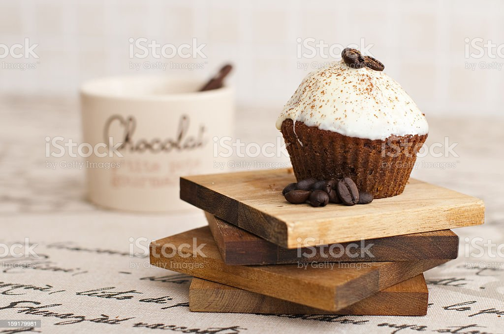 Chocolate muffin on top of a wood stack royalty-free stock photo