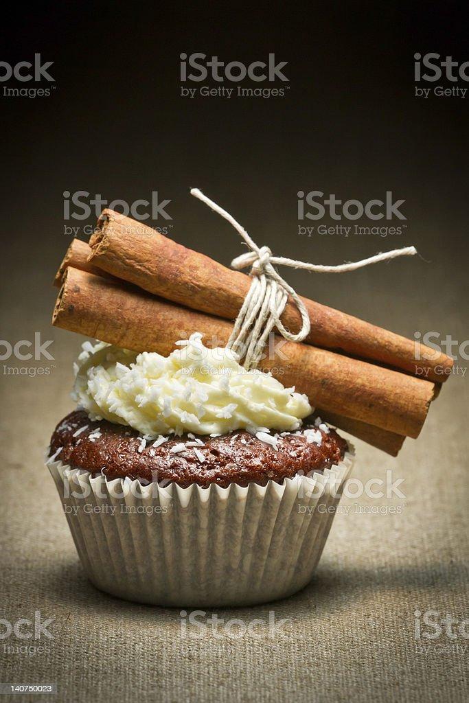 Chocolate muffin  with cinnamon bark and cream royalty-free stock photo