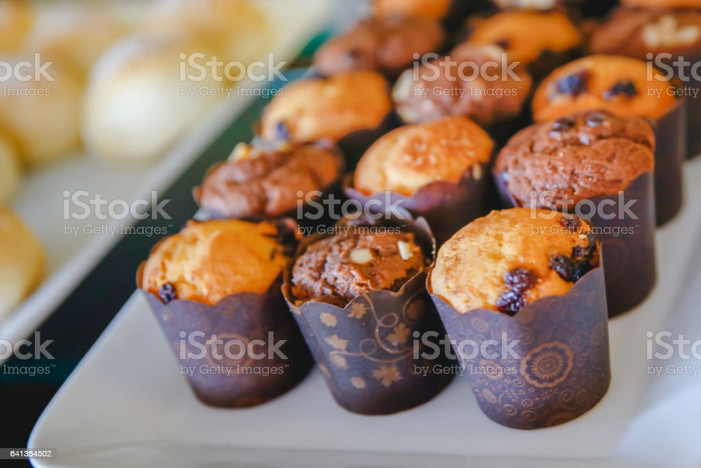 Chocolate muffin with raisin and almond slice stock photo