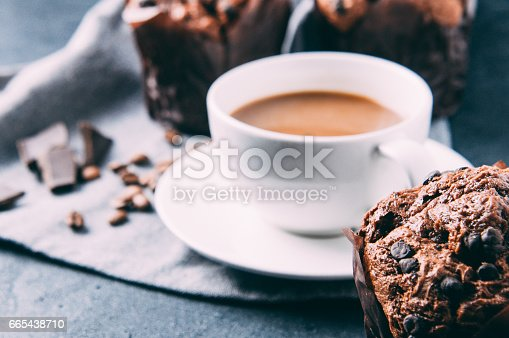 istock Chocolate muffins and coffee on a dark background 665438710