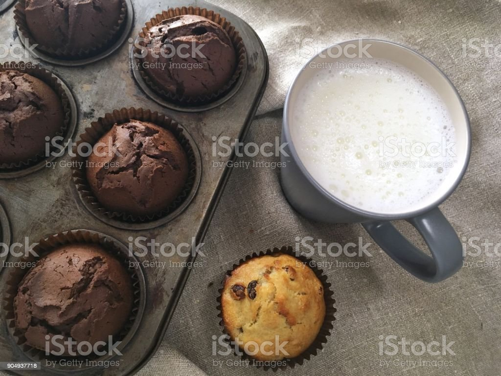 Chocolate muffins and cup of milk stock photo