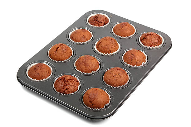 Chocolate Muffins Chocolate Muffins. Isolated with clipping path. muffin tin stock pictures, royalty-free photos & images