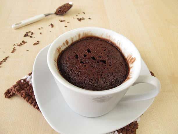 Chocolate mug cake in cup from microwave stock photo