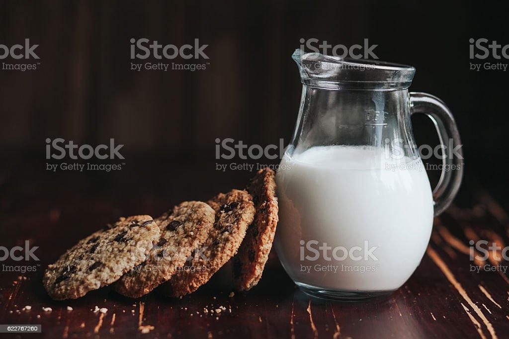 chocolate oatmeal cookies and milk stock photo