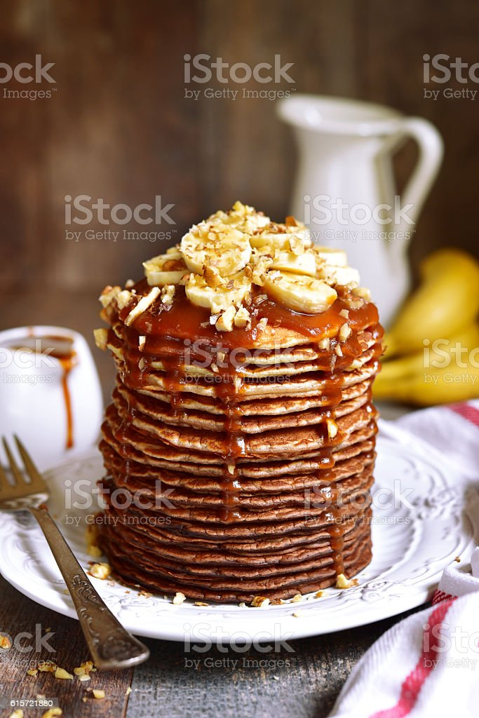 Chocolate ombre pancakes with banana,walnuts and caramel. stock photo