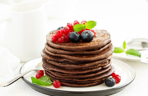 Chocolate pancakes with berries. stock photo