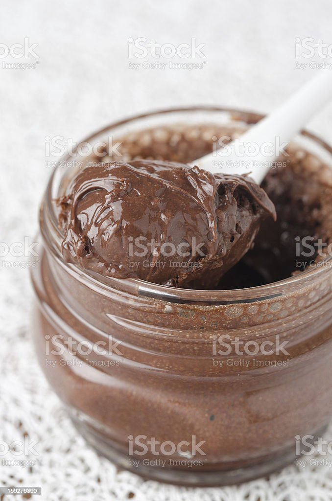 chocolate paste in a glass jar closeup royalty-free stock photo