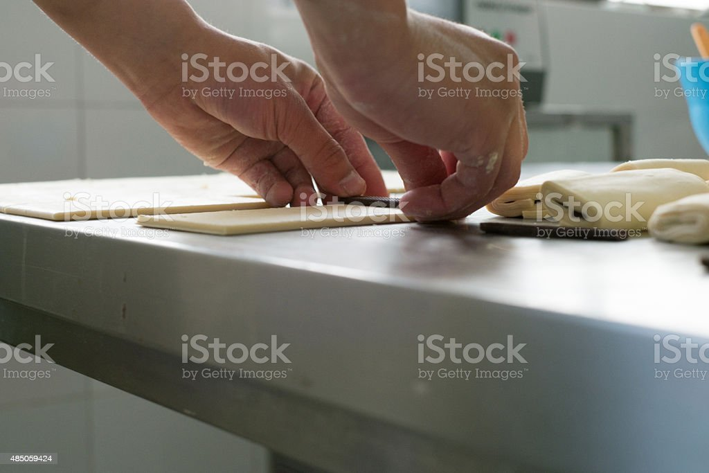 Chocolate Pastry Being Rolled stock photo