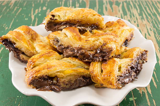chocolate pie slices on a white plate - schokolade gebratene kuchen stock-fotos und bilder