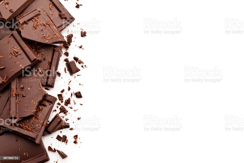 Chocolate pieces border on white background stock photo