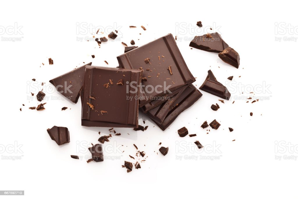 Chocolate pieces isolated on white background-Top view stock photo