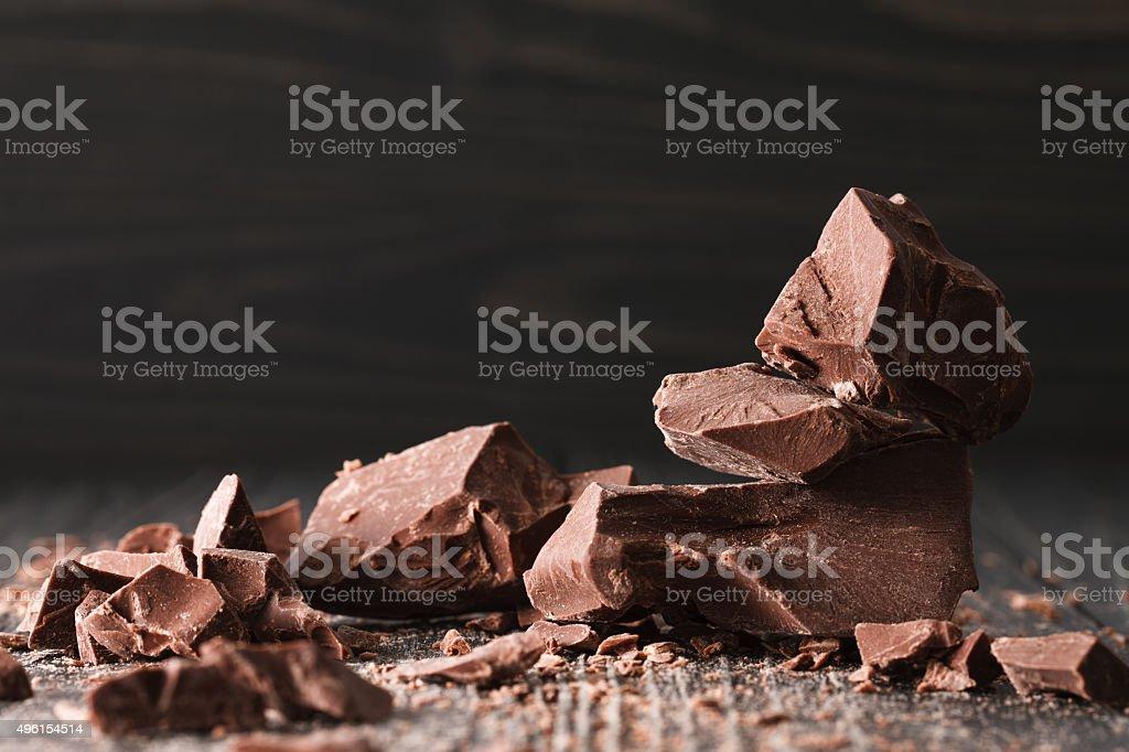 Chocolate pieces on a dark backround stock photo