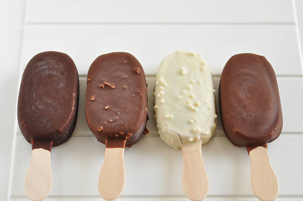 chocolate popsicles chocolate popsicles ice cream bar stock pictures, royalty-free photos & images