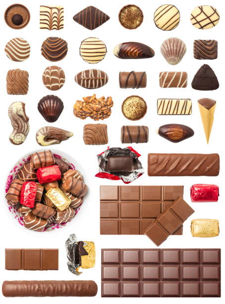 Chocolate Pralines and Tablets Isolated on White Background stock photo