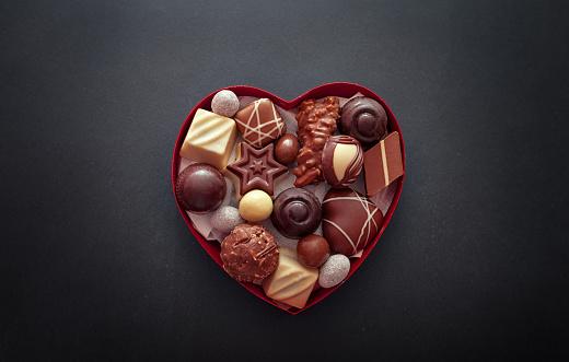 Chocolate pralines in heart shape box