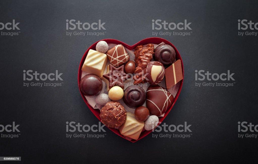 Chocolate pralines in heart shape box stock photo