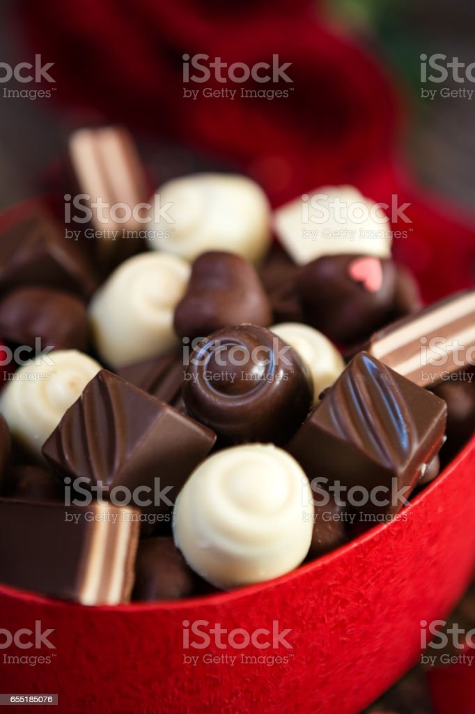 chocolate pralines in heart shaped gift box- Mother's Day stock photo
