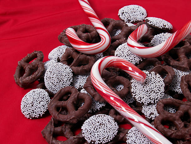 Chocolate Pretzels, Nonpareils and Candy Canes on Red stock photo