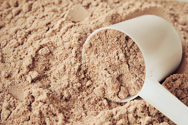chocolate protein powder - protein stock photos and pictures