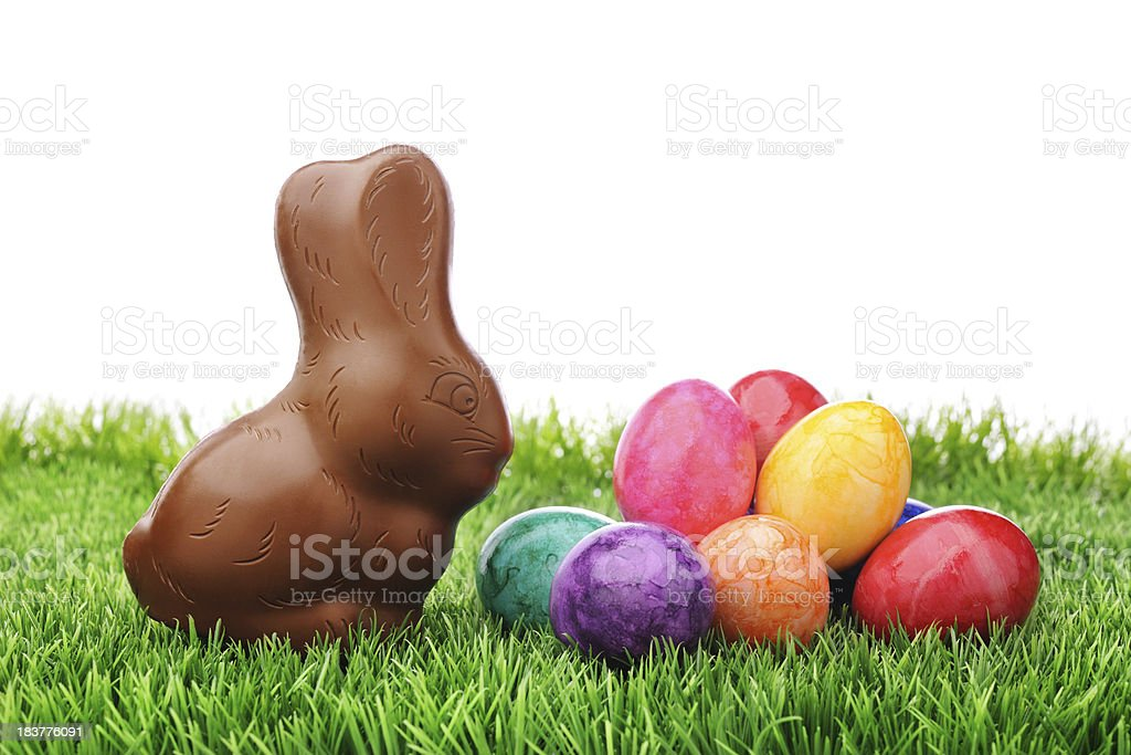 Chocolate rabbit with colorful easter eggs royalty-free stock photo