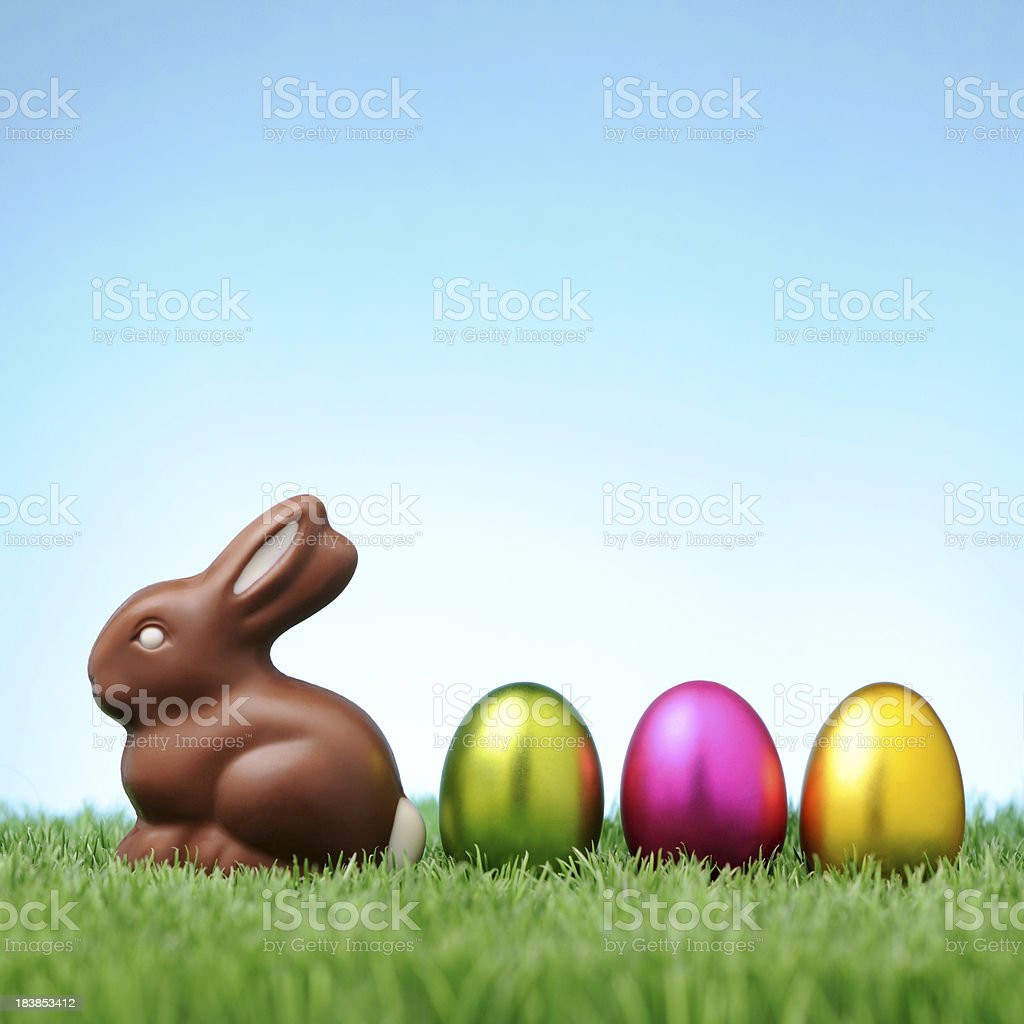 Chocolate rabbit with colorful easter eggs stock photo