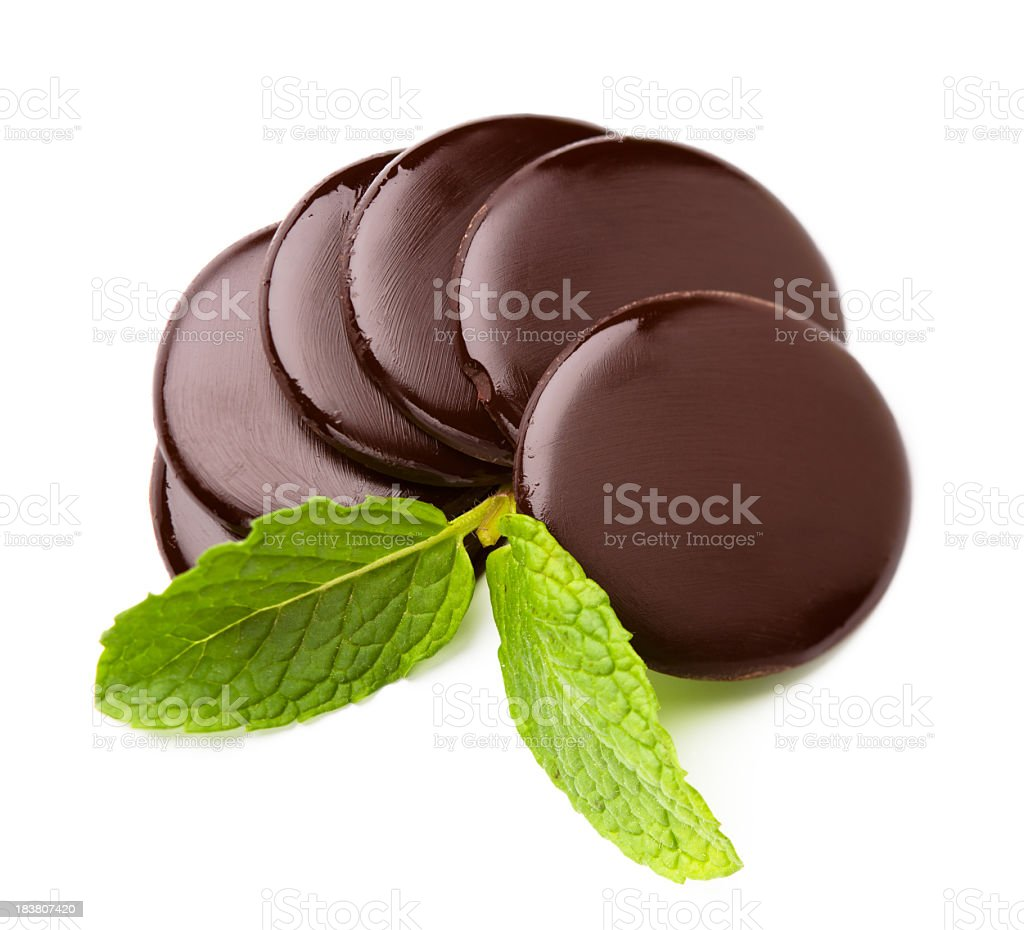Chocolate rounds with mint leaf on white background royalty-free stock photo