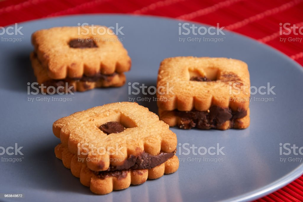Chocolate sand chip cookies stacked up on a plate, ready to be served on blue plate - Royalty-free Baked Stock Photo