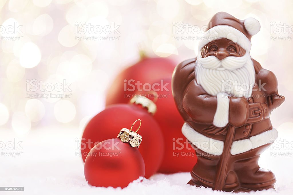 Chocolate Santa and Red baubles royalty-free stock photo