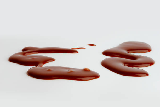 chocolate sauce - chocolate syrup stock photos and pictures