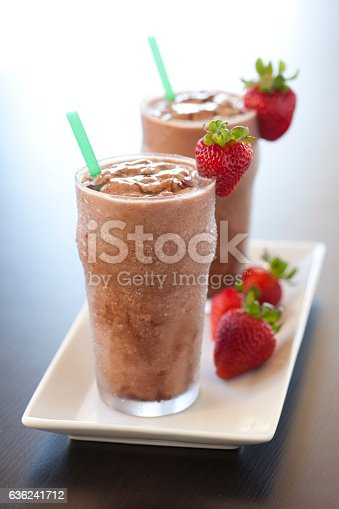two chocolate shakes with strawberry garnish